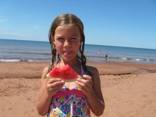 Enjoying watermelon on the beach